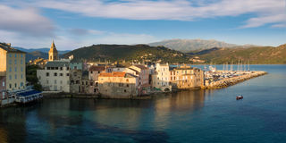 Panorama of beautiful Saint Florent town and harbour, Corsica Stock Images