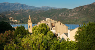 Panorama of beautiful Saint Florent town and harbour, Corsica Stock Photos