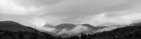 Panorama of a beautiful scenery of misty mountains. Transfagarasan mountains. Romania Royalty Free Stock Photos