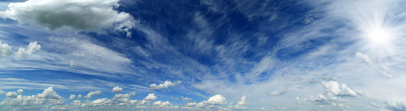 Panorama of beautiful sky with clouds and sun Royalty Free Stock Photography