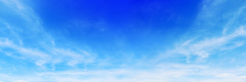 panorama of beautiful soft white clouds on blue sky for backgrou Stock Images