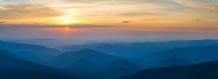 Panorama of beautiful sunrise in mountains landscape Royalty Free Stock Photos