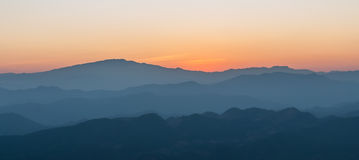Panorama Beautiful sunset. With layers of colors over the mountai Royalty Free Stock Image