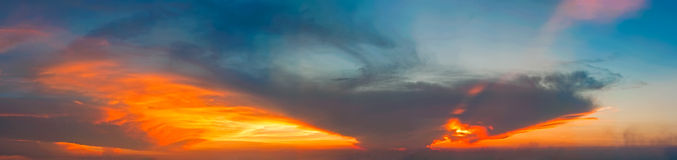 Panorama of beautiful sunset cloud in the sky.  Stock Photos