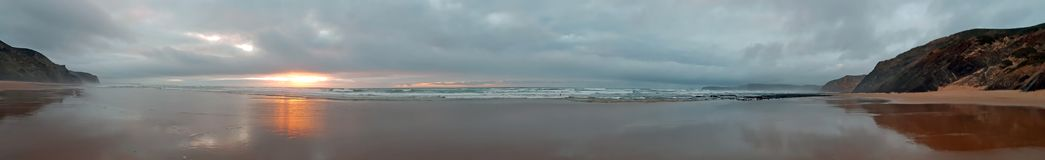 Panorama from a beautiful sunset on a remote beach on the westco Royalty Free Stock Photo