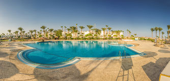 Panorama at beautiful swimming pool and palm trees in Egypt Stock Photo