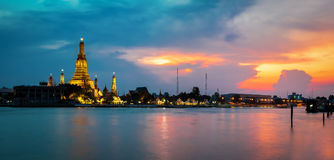 Panorama of the beautiful temple along the Chao Phraya river. At twilight  (Phra Prang Wat Arun in Bangkok Stock Photos