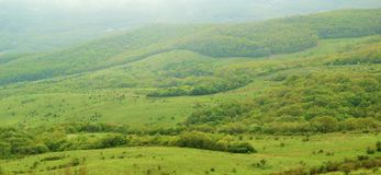 Panorama of Beautiful Valley in Fog Royalty Free Stock Images