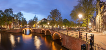 Panorama of beautifull Amsterdam canals with bridge. Holland Stock Photography