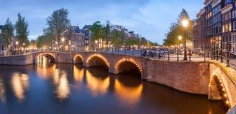 Panorama of beautifull Amsterdam canals with bridge, Holland. Beautiful panoramic view of Amsterdam canals with bridge and typical dutch houses. Holland stock photography