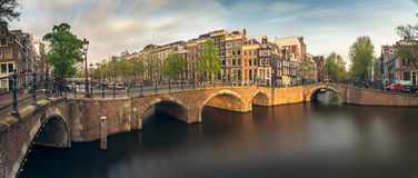 Panorama of beautifull Amsterdam canals with bridge, Holland Stock Photos