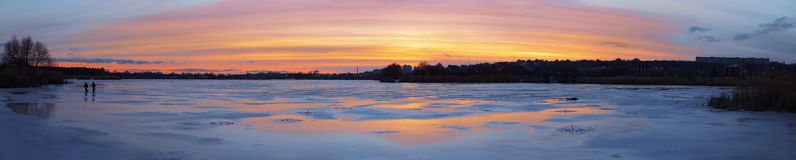 Panorama of the beautifull sunset over icy river Stock Photography