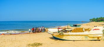 Panorama of Bentota beach with fishermen Royalty Free Stock Images