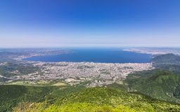 Panorama of Beppu City and Bay between Mountains of Kyushu and green Landscape in the foreground from Mount Tsurumi. Beppu, Oita royalty free stock image
