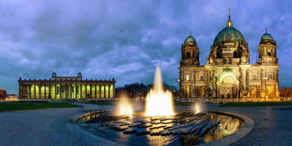 Panorama of the Berliner Dom and the Altes Museum in Berlin by night. Panorama of the Berliner Dom and the Altes Museum at Lustgarten in Berlin, Germany, by royalty free stock images