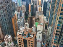 Panorama of the big city from height of bird`s flight, multi-colored skyscrapers and roofs of houses the top view, the modern city royalty free stock photo