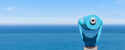 Panorama of binoculars and ocean Royalty Free Stock Photography