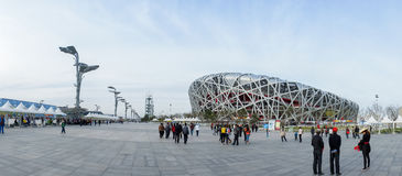 Panorama of Bird Nest China National Olympic Stadium. CHINA - APRIL 11: panorama of Tourist walking around Bird Nest China National Olympic Stadium in Beijing Stock Photography