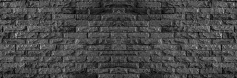 Panorama of black brick wall of dark stone texture and background royalty free stock images