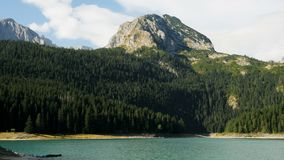 Panorama of the black large lake. With a high mountain stock footage