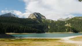 Panorama of the black large lake. With a high mountain stock video