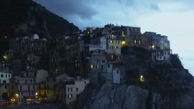 Panorama of blue evening sky and Manarola town, Italian village on cliffs. Stock footage stock video footage