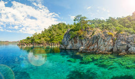Panorama of blue lagoon brightly lit with sinlight Royalty Free Stock Images