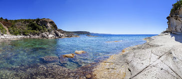 Panorama of blue sea and the rocky reef Stock Photography