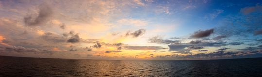 Panorama blue sea and sky with sun red light reflexted in the op. En sea Stock Photos
