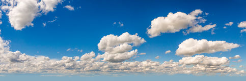 Panorama of blue sky with white clouds. Wide panorama of blue sky with white fluffy clouds Stock Photo