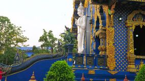 Panorama of Blue Temple, Chiang Rai, Thailand. CHIANG RAI, THAILAND - MAY 10, 2019: Panorama of striking Wat Rong Seua Ten Blue Temple with viharn hall and stock footage