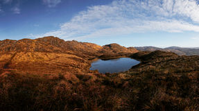 Panorama of the Bluestack Mountains in Donegal Ireland with a lake in the front Royalty Free Stock Photo