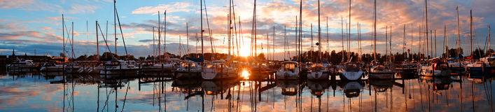 Panorama from boats in the harbo in the Netherlands. Panorama from boats in the harbor from Katwoude in the Netherlands at sunset Royalty Free Stock Photo