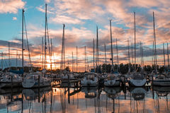 Panorama from boats in the harbo in the Netherlands. Boats in the harbor from Katwoude in the Netherlands at sunset Royalty Free Stock Photo