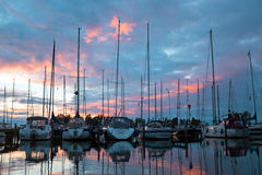 Panorama from boats in the harbo in the Netherlands. Boats in the harbor from Katwoude in the Netherlands at sunset Royalty Free Stock Photos