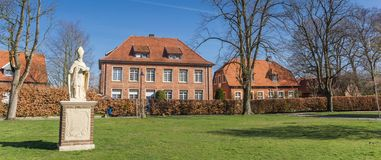 Panorama of the Boniface statue and historic houses in Freckenhorst royalty free stock image