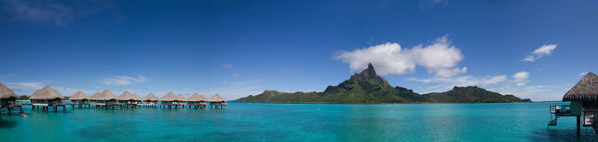 Panorama of Bora Bora with Overwater Bungalows. Panorama of Mt. Otemanu in Bora Bora, French Polynesia with Overwater Bungalows stock image