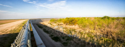 Panorama of border wall separating united states and mexico. A sweeping panoramic view of border wall separating united states and mexico in texas royalty free stock photos