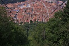 Panorama of Brasov, Romania. Panorama of Brasov surrounded by trees royalty free stock photo