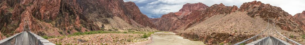 Panorama of Bridge over Colorado River in Grand Canyon Royalty Free Stock Photography