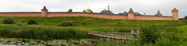 Panorama of the bridge over the river Kamenka and the Saint Euthymius monastery in Suzdal. Russia. Royalty Free Stock Photography