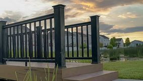 Free Panorama Bridge With Wooden Deck And Black Guardrail Over A Small And Shiny Pond Royalty Free Stock Images - 154864119