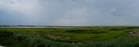 Brigantine Bay Marsh and Tidal Wetlands Panorama. Panorama of Brigantine Bay and marsh and tidal wetlands with Brigantine, New Jersey, in the background royalty free stock image