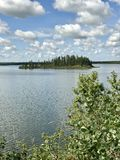 Panoramic view in Elk Island National Park`s Astotin Lake in Alberta. Panorama on a bright summer day in one of Alberta Canada`s many National Parks stock images