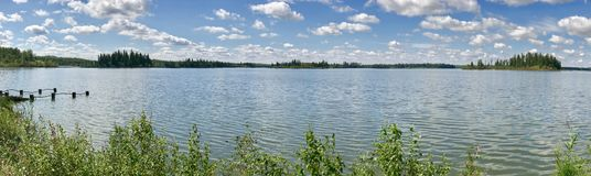 Panoramic view in Elk Island National Park`s Astotin Lake in Alberta. Panorama on a bright summer day in one of Alberta Canada`s many National Parks royalty free stock image