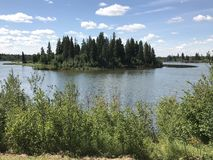 Panoramic view in Elk Island National Park`s Astotin Lake in Alberta. Panorama on a bright summer day in one of Alberta Canada`s many National Parks royalty free stock images