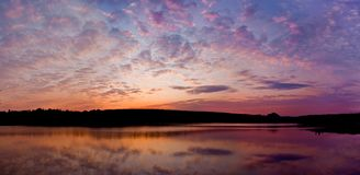 Panorama of bright sunset above the lake Royalty Free Stock Photos