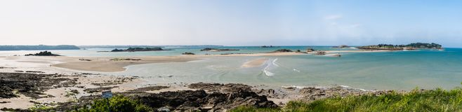 Panorama of Brittany near Saint Malo. Blue sea, sandbanks and small rocky islands, a typical pays de Bretagne near Saint Malo Royalty Free Stock Photos