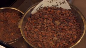 Cocoa beans in a steel bowl in chocolate store. Panorama of a brown cocoa beans in a steel bowl in chocolate store in Belgium stock footage
