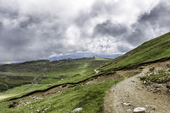 A panorama from Bucegi mountains, Romania, during a summer day, with beautiful clouds. A path through the mountains Royalty Free Stock Photo